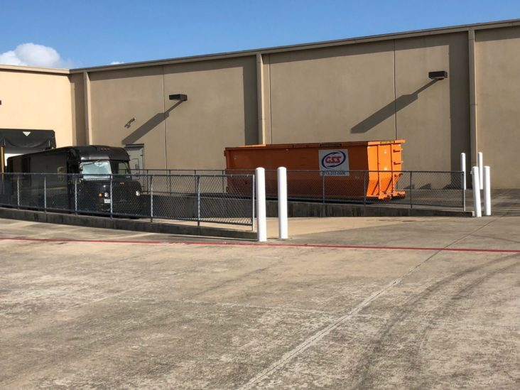 A roll-off is typically an open top dumpster characterized by a rectangular footprint, utilizing wheels to facilitate rolling the dumpster in place.